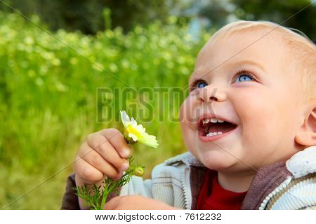Small Baby Laughing With Daisy