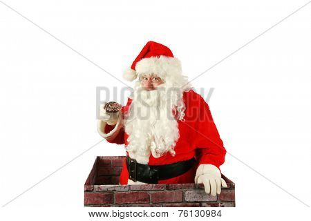Santa Claus in a Chimney. Santa Claus exits a house through the chimney after delivering presents for all the good boys and girls with a donut that was left for him as a thank you gift. Santa Claus