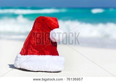 Santa Hat On White Sandy Beach
