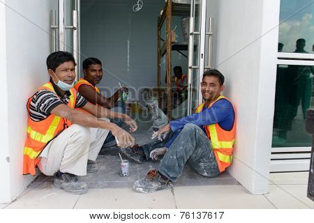 KUALA LUMPUR-MAY 06: builders in airport on May 06, 2014 in Kuala Lumpur, Malaysia. Kuala Lumpur International Airport is Malaysia's main airport and one of the major airports of South East Asian