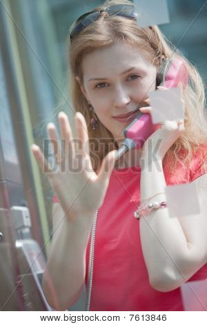 Young Casual Woman In Call Box