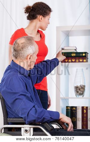Disabled And Nurse In Living Room