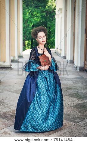 Beautiful Woman In Blue Medieval Dress With Book