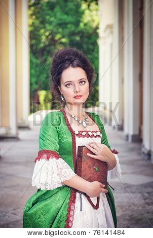 Beautiful Woman In Medieval Dress With Book