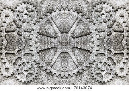 gears carved into the rock