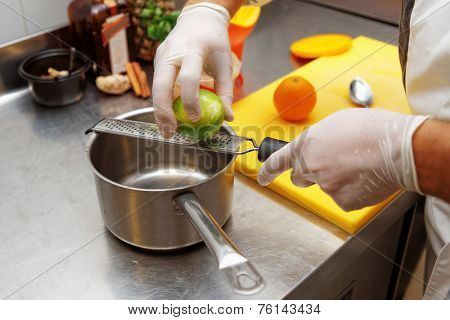 Chef is zesting lime in commercial kitchen