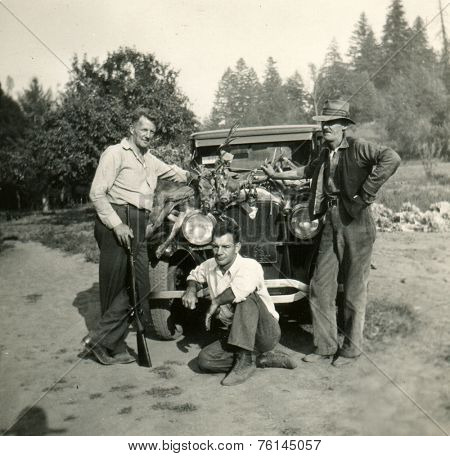 CANADA - CIRCA 1920s: Vintage photo shows hunters and their prey.