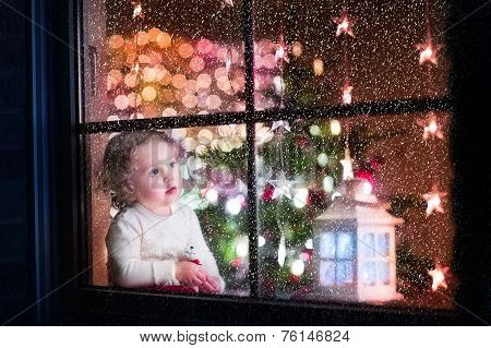 Cute curly toddler girl during Christmas time, to celebrat