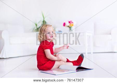 Little Adorable Girl Reading A Book