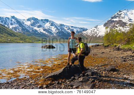Sportsman And Woman Near Mountain Lake