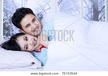Happy Couple Jest On Bed