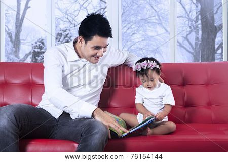 Lovely Girl And Father Read Story Book