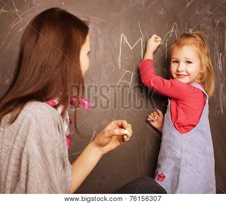 teacher with pupil in classroom