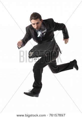 Young Attractive Businessman Running Late To Work  In Stress