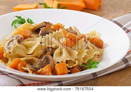 Pasta in cream sauce with slices of pumpkin and mushroom