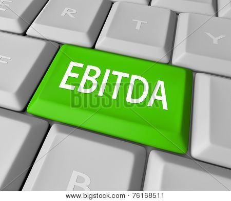 EBITDA word acronym on a computer keyboard key or button to calculate profit, revenues and earnings before interest, tax, depreciation and amortization