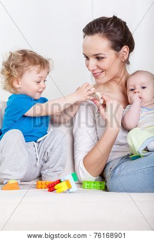 Mother And Babies During Free Time