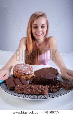 Young Girl Holding A Plate Of Sweets