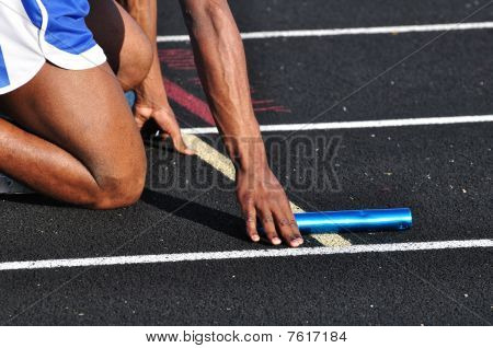 Teen Boy In The Starting Blocks
