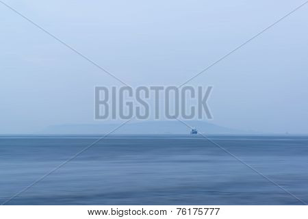 Image Of Single Freight Boat In Open Sea With Vast Open Space