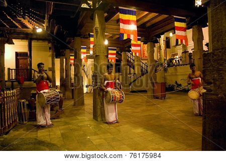 Kandy, Sri Lanka - May 15: Three Drummers Beat Their Drums During The Evening Worship Services In  I