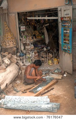 Burmese Man Working A Brass At Myanmar Art Work.