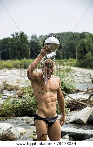 Shirtless Muscular Young Pouring Water On His Head