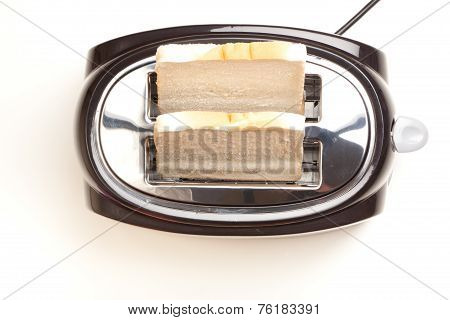 Black Toaster, Two Slices Of Bread, On White Background