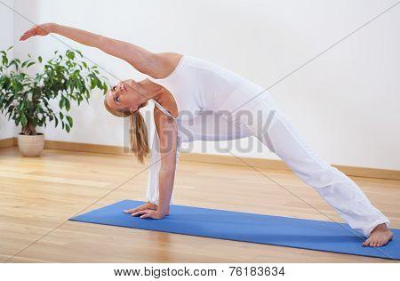 Woman Doing Advanced Yoga Exercise