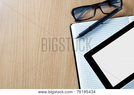 Modern Tablet Pc Next To A Classical Open Agenda