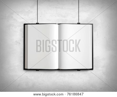 Open Blank Textbook On White Concrete Wall