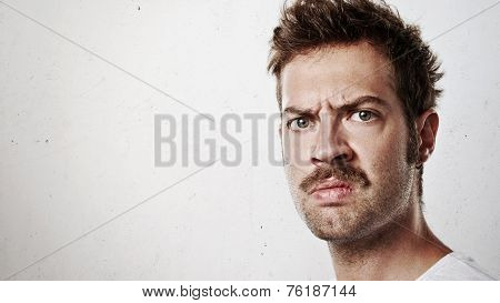 Portrait Of An Angry Man With Mustache
