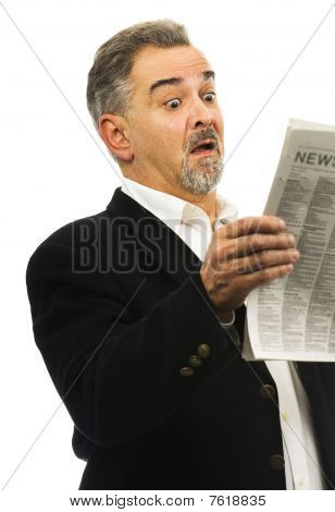 Man Looks At Newspaper With Look Of Shock