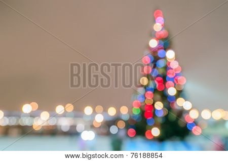 Defocused Christmas Tree Silhouette With Lights