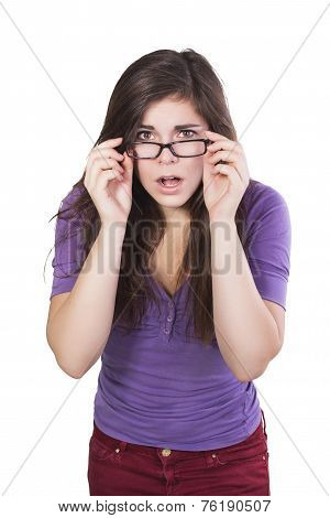 Brunette woman in glasses peering in amazement isolated on white
