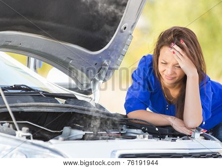 girl with a broken car