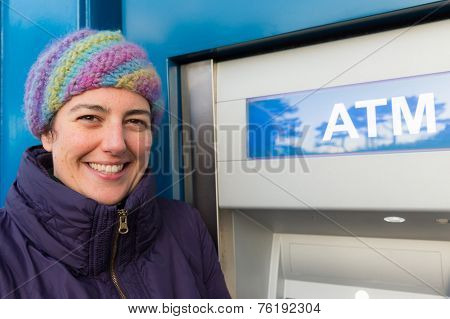 Smiling Woman Standing At An Atm