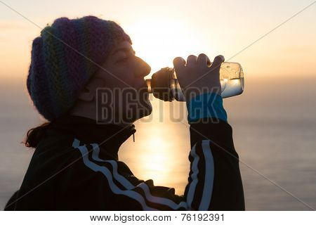 Woman Sipping Water From A Bottle