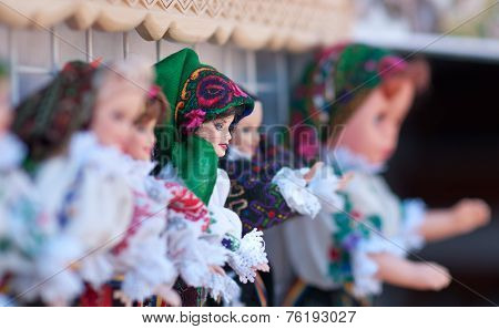 Romanian traditional colorful handmade dolls, close up. Dolls to be sold at souvenir market