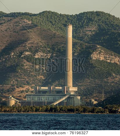 MUGLA / TURKEY; JUNE 31: Kemerkoy Thermal power plant in Gokova during sunrise on June 31, 2014. The plant's stack is 300m tall, the tallest in Turkey at the time of construction