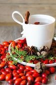 picture of wild-brier  - Christmas time table decoration with rose hips and tea with christmas tree branches - JPG
