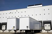 stock photo of oversize load  - Loading docks under blue sky - JPG