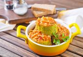 stock photo of marrow  - stuffed marrow with tomato sauce in the bowl - JPG