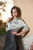 stock photo of blouse  - Elegant glamour woman wearing brown skirt and blouse outdoor in the park at sunset - JPG