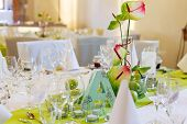 foto of wedding table decor  - Elegant table set in white and green with apples for wedding or event party in a castle - JPG