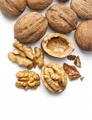 image of walnut  - walnut and a cracked walnut isolated on the white background with clipping path - JPG