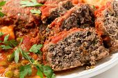 picture of meatloaf  - Homemade meatloaf baked in tomato sauce with peas and potatoes - JPG