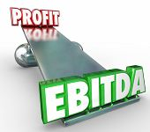 stock photo of amortization  - EBITDA and Profit words in 3d letters on a scale or balance to weigh the benefits of the accounting method for reporting earnings before interest - JPG