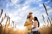 pic of father time  - Happy pregnant family with little daughter spending time together in sunny field - JPG