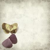 stock photo of kirigami  - textured old paper background with kirigami butterfly - JPG